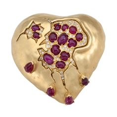 "The ""Pomegranate Heart"" was designed by Dali in the 1950's with rubies and diamonds. This example was fabricated by Henryk Kaston who made all of Dali's jewelry from 1980 to 1990. The brooch is signed ""Dali by Kaston""."