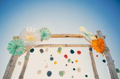 florida beach wedding pinwheels and pom pom arbor