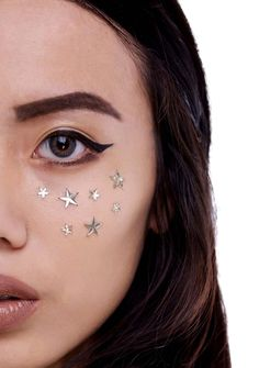 In Your Dreams Gold Zorya Face Jewels cuz yer stars have aligned. These self adhesive magical star shaped jewels come in a variety of sizes and can easily be worn in yer hair or on yer face and body. Featuring an easy pull and peel application, there is an infinite amount of embellished possibilities bb.