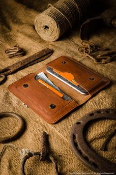 This simple wallet was designed to hold two iPhone 7 or iPhone 7 plus size phones, your cash or cards in one compact and safe haven. It is made of premiumCrazy
