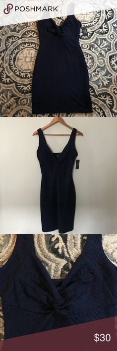 """NWT GUESS SALENA Navy Dress, Full Lining New with tags, GUESS SELENA navy stretchy dress with full navy lining. Fits close to the body & outlines the curves; very flattering fit & style. Has side hidden zipper. Sz 8 & I think it will fit sz 6 too with the stretch it has. Has beautiful raised navy diagnol design on the navy fabric. 97% polyester, 3% spandex. Lining 100% polyester. Chest 34"""", length from shoulder to bottom of dress 36"""", waist 29"""". Clean, non-smoking home. Posh Ambassador…"""