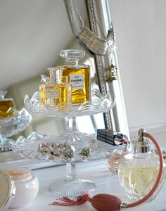 Vintage cake stands as dressing table organization.
