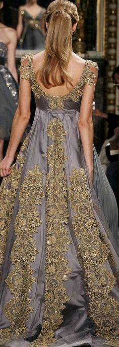 Love the embroidery and colours. Interesting colour for the dress but goes well with the gold