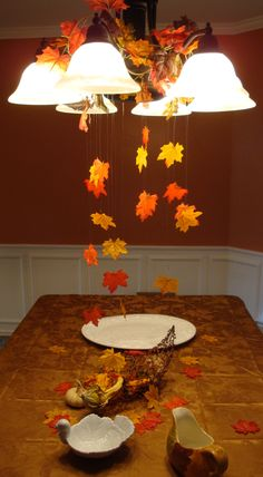 Fall Crafts and DecorUsing fishing line and a bag of leaves from from the dollar store to create a fall scene for the Thanksgiving table! Hung from the light with colored paper clips to blend in! Spread out excess leaves on the table Thanksgiving Tree, Thanksgiving Pictures, Thanksgiving Parties, Diy Thanksgiving Decorations, Hosting Thanksgiving, Thanksgiving Traditions, Thanksgiving Recipes, Thanksgiving Appetizers, Thanksgiving Cookies