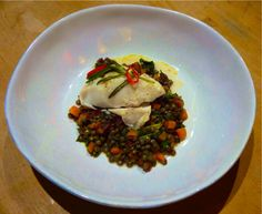 Cod loin with rosemary & chilli en papillote. Served on a bed of Le Puy lentils with red onion, carrot, chorizo, Marsala, balsamic, basil, parsley, spinach, kale and chard.