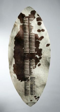 Africa | Classical form shield from the Zulu shield from South Africa | Cowhide | ca. 1947