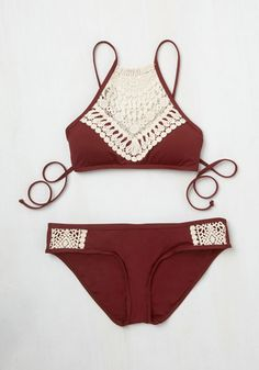 Make midday even more marvelous by slipping into this burgundy bikini top for a glide along the water's surface. Floating face-down, you show off the double-crisscrossing back of this boho-inspired piece, and when you flip over for a breath, its ivory, crocheted high neckline is sure to impress!