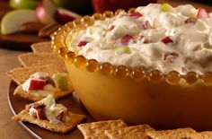 Caramel Pecan Cheese Dip...1 package (8 oz.) cream cheese, softened,    1/4 cup caramel ice cream topping,   1/2 cup chopped pecans, toasted, divided, 1 cup chopped apple,   1 cup frozen non-dairy whipped topping, thawed, Keebler® Wheatables® Original Golden Wheat crackers.