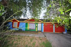 Houston, Texas home. Super bright red, yellow, green, blue exterior paint ...