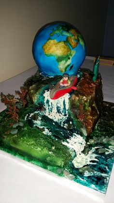 Canoeing cake made with airbrushed buttercream. Earth cake on top