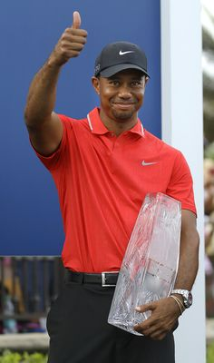 Sporting News Archive: THE PLAYERS In the first image:  Tiger Woods gives...