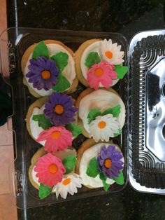 Vanilla cupcakes with gum paste flowers.