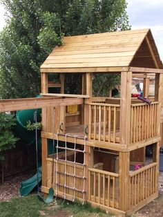 5'x5' clubhouse with 3'x8' porch with wooden roof, cargo net entry, 7' enclosed spiral slide, pirate package, enclosed 5'x5' bottom with 3'x8' porch, pink wheel, 16' monkey bars with one ladder, 2 standard swings, 1 baby bucket, 1 trapeze bar. Connected to a previously built 8' 1/2 Octagon with partial roof, Fireman Pole Exit, 8' Climbing Wall Entry with Rope, Molded Rock Entry, Basketball Hoop, Bucket Drop Down Feature and half enclosed bottom for Power Wheel Cars.