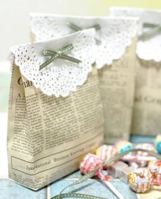 newspaper gift bags - love the doily on top!