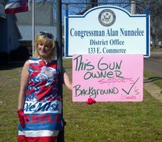 Kelly Jacobs of Hernando, Mississippi, protesting in front of Congressman Alan Nunnelee's office in Supporting gun Control, wearing the Ole Miss rebel dress she made.