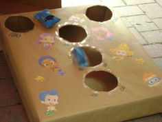 Made this toss game from an old box.  (Under the sea and Bubble Guppies Themed party).