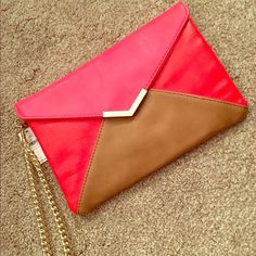 Brand new express color block clutch Brand new with tags color block clutch. Button closure. Removable chain strap. Gold detail on front. Express Bags Clutches & Wristlets