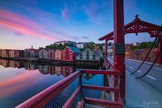 https://flic.kr/p/28FCfgb | Summer colors  over Bybrua, Gamle bybro (town bridge) in Trondheim | website: www.aziznasutiphotography.com       Gamle Bybro crosses the Nidelva River from the south end of the main street Kjøpmannsgata connecting to the Trondheim neighborhood of Bakklandet. Gamle Bybro was constructed by Johan Caspar von Cicignon in 1681 in conjunction with the reconstruction of Trondheim after the great fire of 1681.