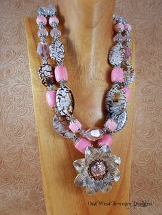 Check out this cute, chunky, double strand, rodeo cowgirl necklace!! I put it together using some large, cream and brown fire crackle agate ovals that resemble exotic animal print, large, pink howlite barrel beads, pink howlite rondelles and pumpkin beada, small, rose quartz rondelles, rose pink beach glass rondelles, faceted, rose pink Chinese crysatl rondelles, faceted, translucent rose pink Chinese crystal rondelles and some large, faceted, rose pink Chinese crystal nuggets. Lots of nice…