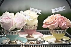 Vintage tea cups filled with gorgeous roses. This is a perfect idea for bridal shower table places. I just love this idea… so girly girl.
