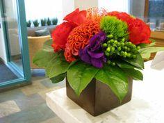 """Read:  """"Vibrant Flower Arrangements""""  #floral arrangements Image: www.flymetothemoonflorists.com #flowers #flower arrangements"""