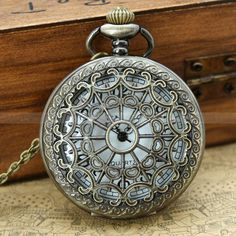 Vintage pocket watch necklace with antique bronze heart zodiac and leaf charm. $4.99, via Etsy.