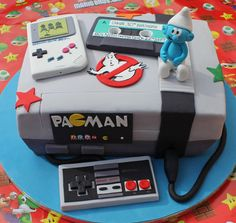 Personalised geek cake with a Nintendo 8-bit console. Hate how everyone assumes this is for a boy, why can't girls like this stuff? I know I did when I was a kid, and still do.