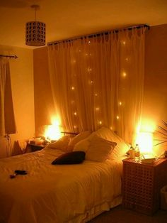 So want to do this! Hang a curtain and string lights behind the bed frame!