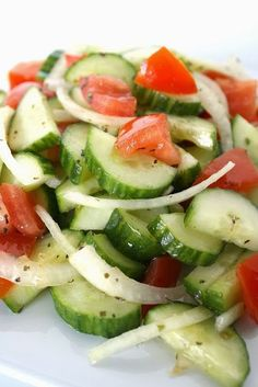 Simple cucumber salad with tangy white wine vinegar dressing. So crisp and refreshing!