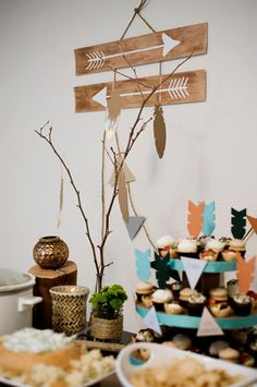 Get inspiration for your Little Warrior or Little Indian tribal-themed baby shower or birthday party. Simple triangle cut-outs and painted arrows make great theme decor— for a party or nursery!