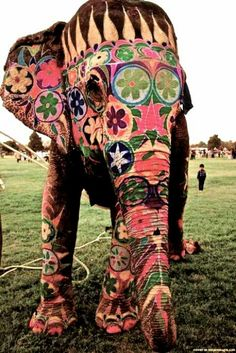 I love this. A decorated elephant... would make a great bead.