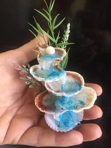 Fairy fountain sea shell minature, fairy accessories, terririum fountain,miniature sea shell fountain,Sea Shell Waterfall,fairy accent   Perfect accent to any miniature fairy garden or terrarium  Measures: 3 aprx. in height