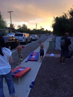 Sunset corn hole games at our First Annual Scorchin' Pig Roast!