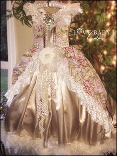 """Made up in shimmering satin and a gorgeous vintage tea party print cotton, this dress is sure to suit her perfectly. """"Garden Of Glamour"""" is inspired by the Victorian era, with its gorgeous full skirts"""
