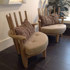 Lovely easychairs by Guillerme & Chambron, nice with different back cushions.   From a unique collection of antique and modern club chairs at https://www.1stdibs.com/furniture/seating/club-chairs/