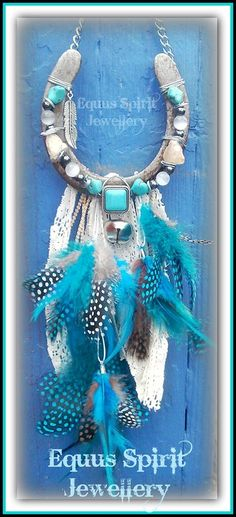 Preloved horseshoe wirewrapped with White Opal,Turquoise and Hematite gemstones with vintage lace and feathers By Equus Spirit Jewellery.