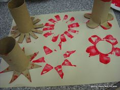 Painting with toilet paper rolls. Cut and spread edges to print flowers and stars with end of tube.
