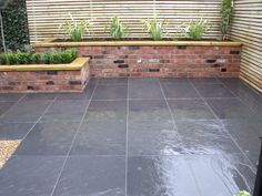 Slate paving and raised brick planter in Wilmslow, Manchester