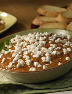 Dip into this creamy Tomato and Peppered Goat Cheese Fondue at your next party or event!