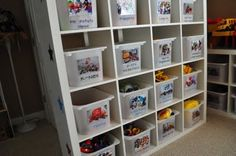 Another Ikea expedit bookshelf for toy organization. Bins and shelves are color coded so toys with little pieces are at the top. Ikea Expedit, Toy Storage, Storage Ideas, Kids Storage, Plastic Storage, Toy Rooms, Vinyl Lettering, Closet Organization, Getting Organized
