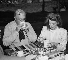 Katharine Hepburn eating chowder with President Franklin Delano Roosevelt at his Val-Kill cottage in Hyde Park, New York, 1940