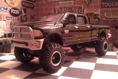 1//64  Dodge Ram 2500  Quadcab 4 x4  puller truck w wide tires     Red or Black