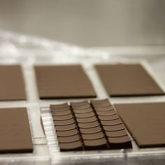 Our perfectly tempered bars coming out of their moulds this morning. All our bars are handcrafted and individually hand wrapped with love. Hand Wrap, Cocoa, Chocolate, Photo And Video, Desserts, Instagram, Tailgate Desserts, Deserts, Chocolates