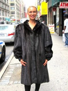 Pre-Owned XXXL Natural Mahogany Female Mink 3/4 Swing Coat    Check out this striking XXXL natural mahogany mink 3/4 swing coat. It has slash pockets, a shawl collar and bracelet cuffs. It's made from silky let out female skins from the USA and it has a nice rich color. The coat has hook & eye closures, the lining is in excellent condition and this garment has a monogram.    http://www.cowitfurs.com/fur-gallery/3-4-coats/page/4/