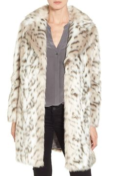 Gorgeous faux leopard fur brings instant glam to this cozy three-quarter-length coat that will be perfect for staying warm on chilly days.