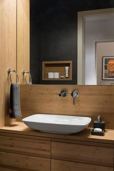 The wood helps to show off the vanity fittings
