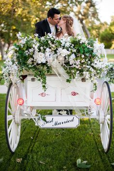 Bride and groom in horse-drawn carriage by @Emma + Josh | Two Bright Lights :: Blog