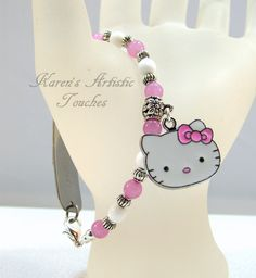 Karen's Artistic Touches Store - Hello Kitty Charm Pink White Medical ID Replacement Bracelet, $15.99 (http://www.karensartistictouches.com/hello-kitty-charm-pink-white-medical-id-replacement-bracelet/)