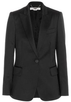 Stunning Stella McCartney Black Iris Blazer with impeccable tailoring.  Classic Iris Blazer with a fitted waist.  Single breasted with one button fastening, peaked lapel and Stella McCartney signature four button cuff.  Front flap pockets and breast pocket.  Fully lined and 100% wool. Size 38.
