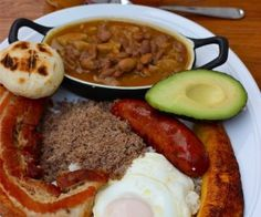 "Bandeja Paisa is probably the most popular Colombian dish, originally from the Andean region of the country where the people are called ""Paisas"" and the area Colombian Dishes, My Colombian Recipes, Colombian Cuisine, Colombian Culture, Colombian Breakfast, Ripe Plantain, Breakfast Platter, Spanish Dishes, Spanish Food"